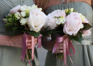 Bridesmaids pale pink peonies with gardenia flowers