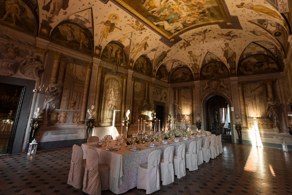 Frescoed hall with silver candelabras