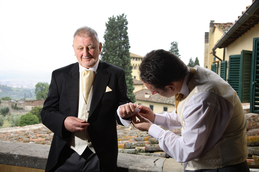Grooms preparation for wedding ceremony