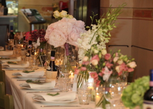 Pink floral decorations on long table