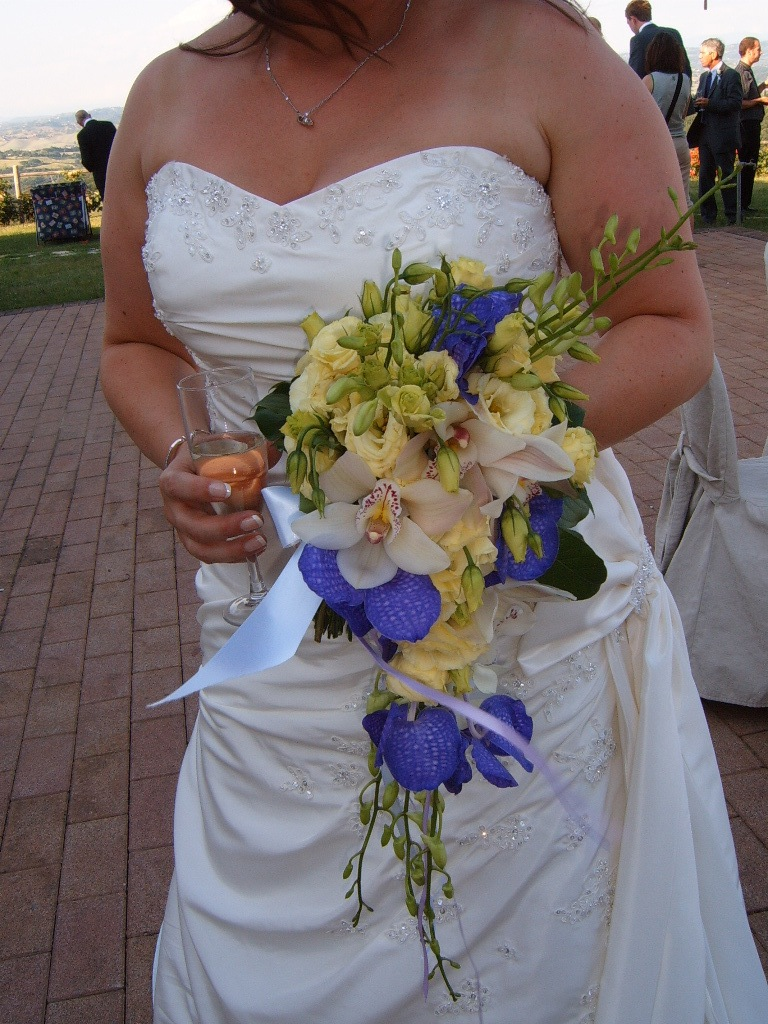 Bridal flower bouquet purple iris and ivory orchids