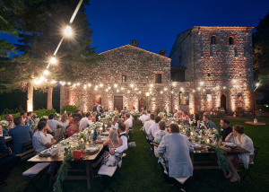 String lights in rustic Tuscan castle