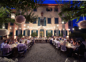 Wedding dinner in Tuscan villa illuminated with string lights