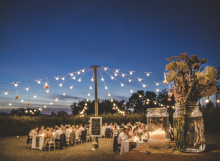 String lights for Tuscan wedding dinner