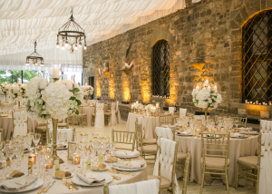 Wedding hall in medieval castle illuminated with amber spots