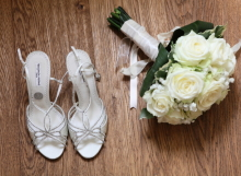 Brides bouquet with ivory roses and gpsophila