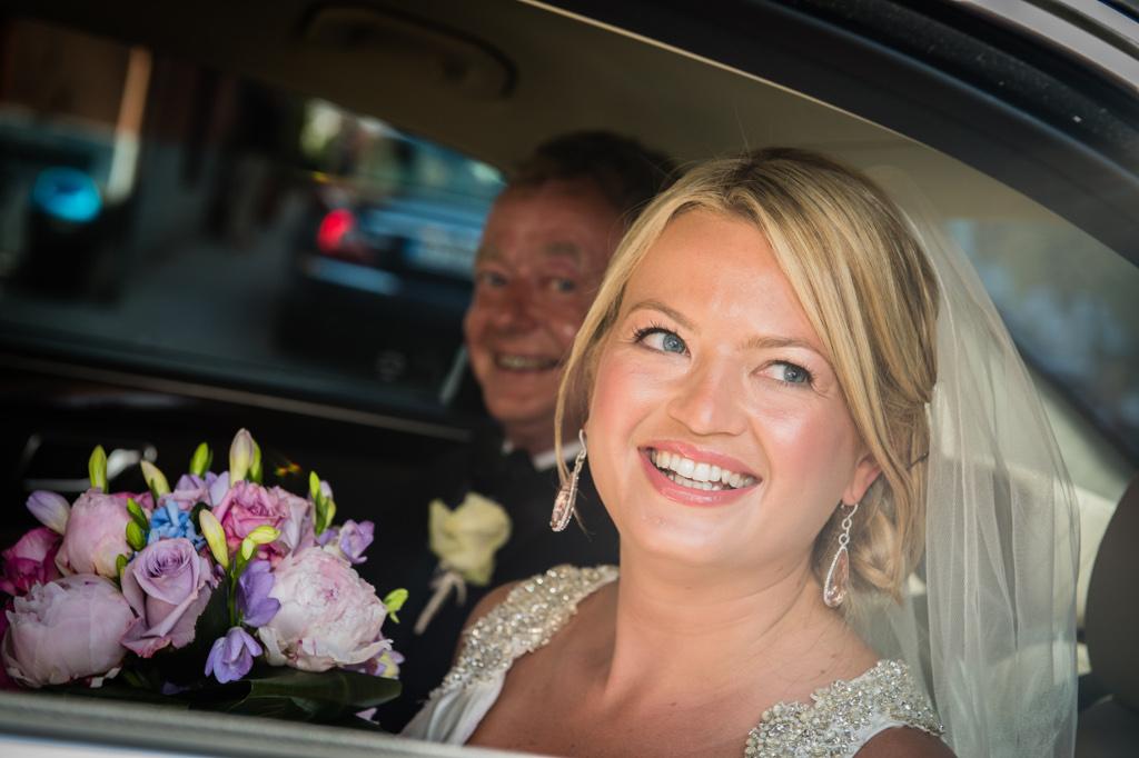 Bride arrives to wedding ceremony