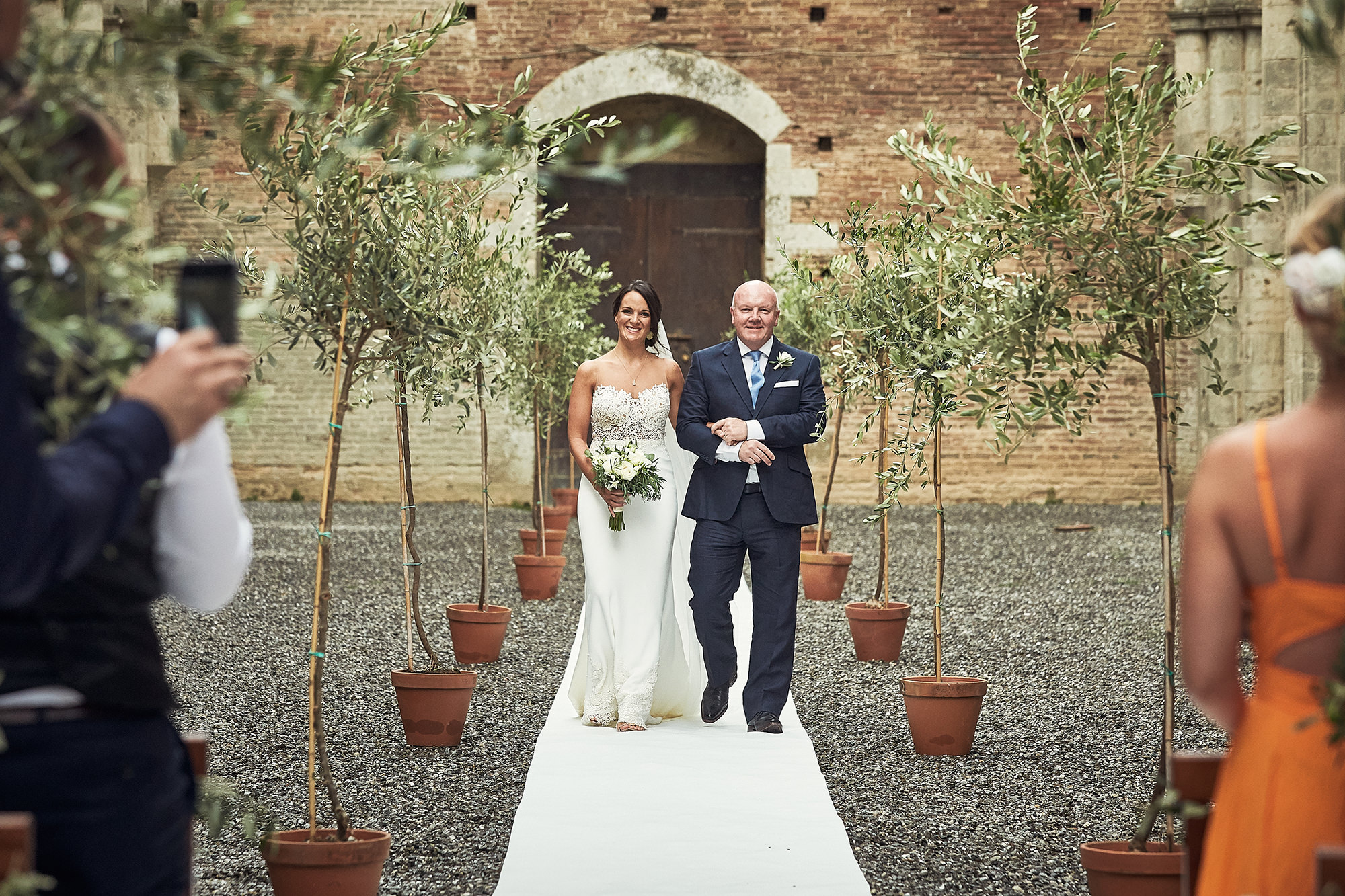 Wedding ceremony in roofless church in Tuscany