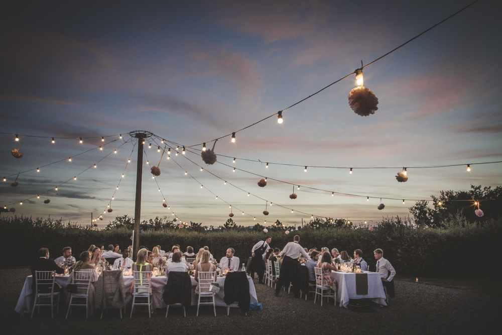 String lights with central pole Tuscan wedding illumination