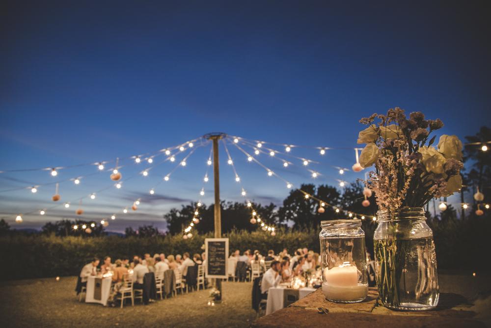 String lights for Tuscan wedding dinner