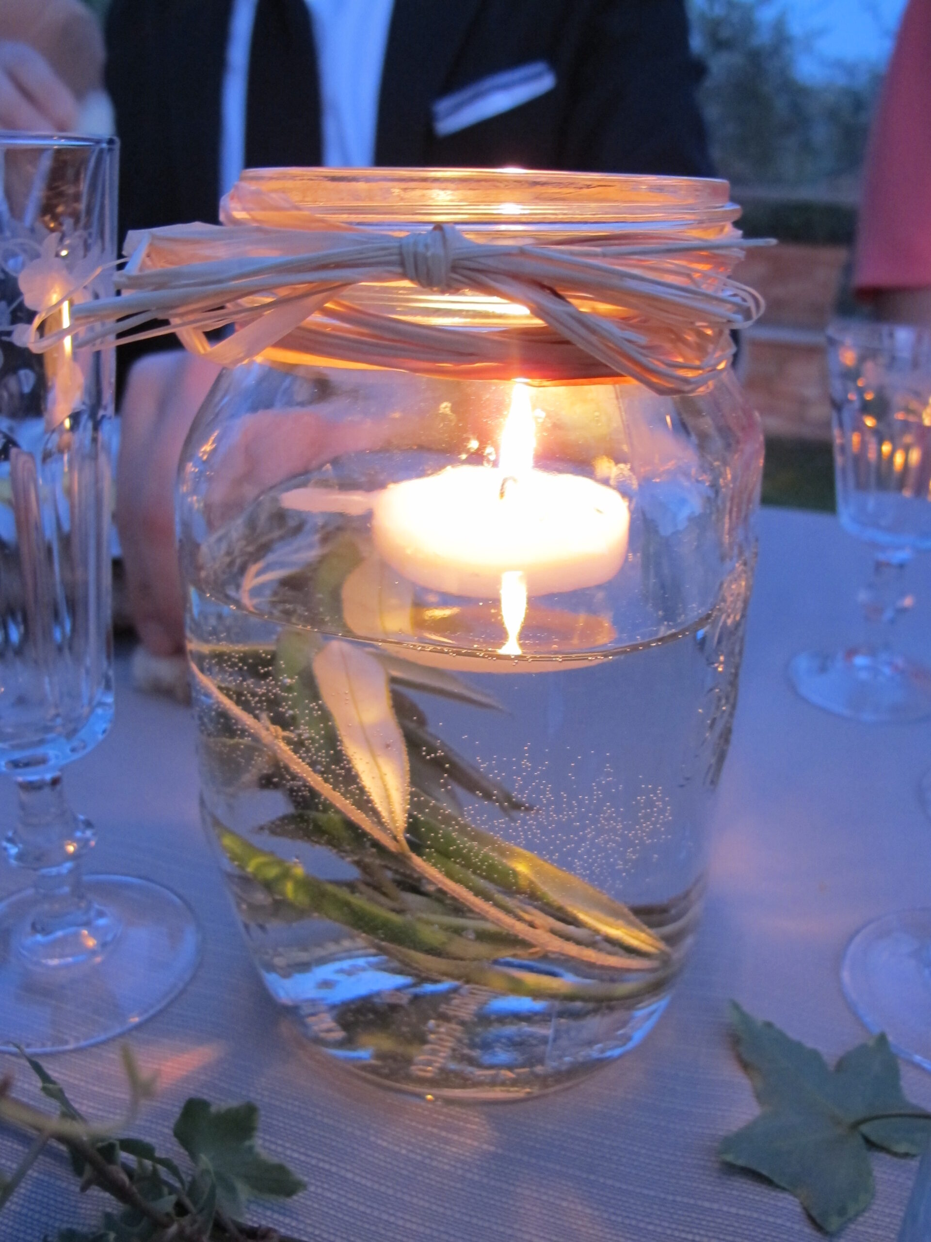 Rustic jam jars with candles for pre wedding parties
