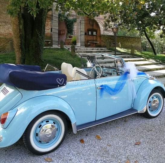 Light blue Volkswagen with open roof